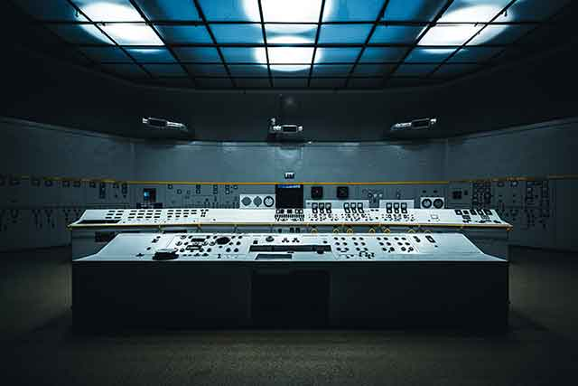 Photo of a dimly lit room with a computer interface terminal.