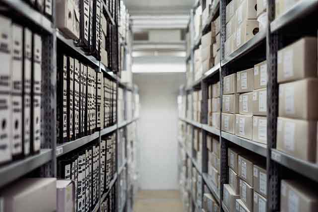Photo of a warehouse with stacked shelves.